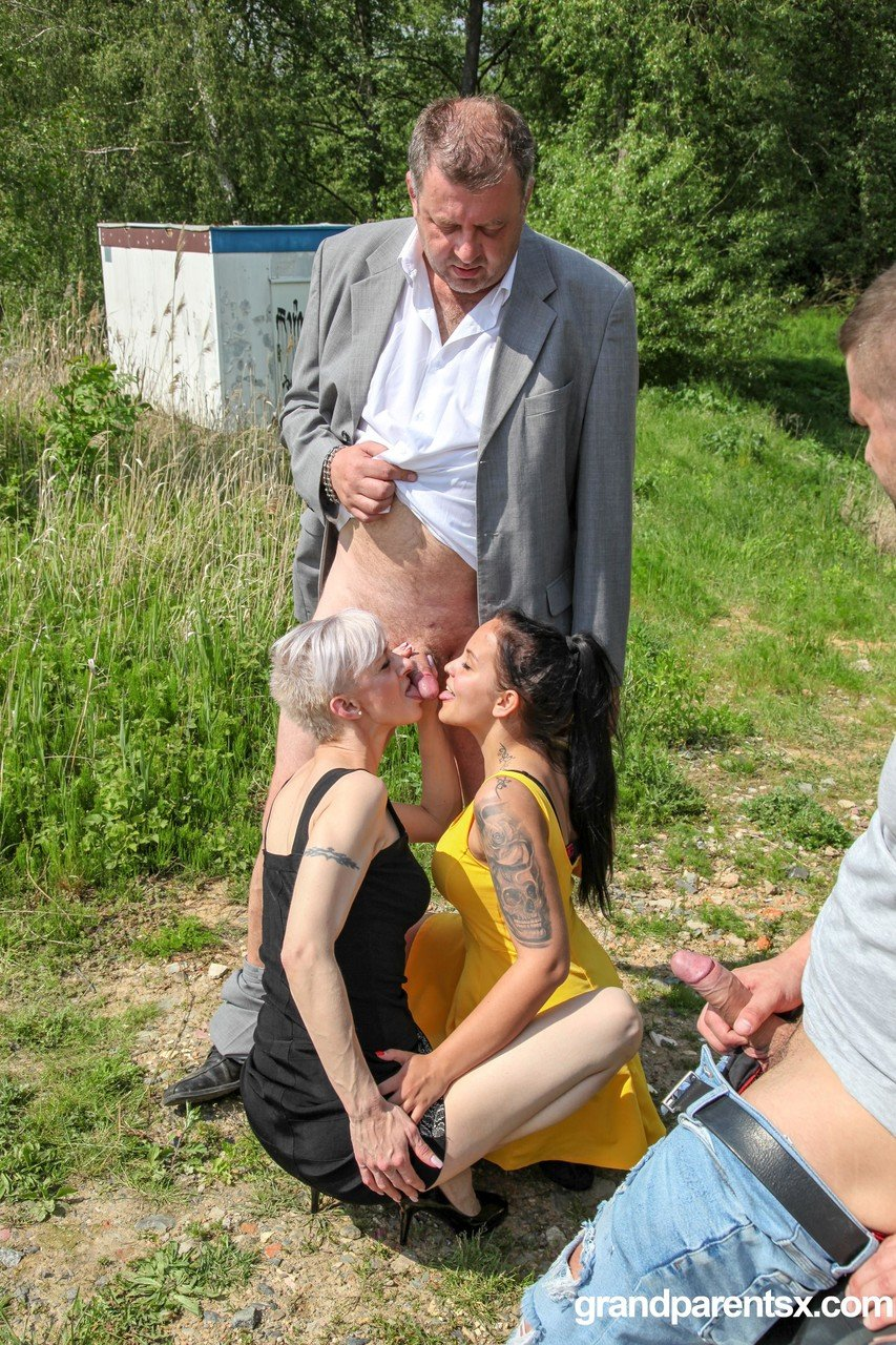 Mature couple enjoying a hardcore foursome with a teen couple by the road
