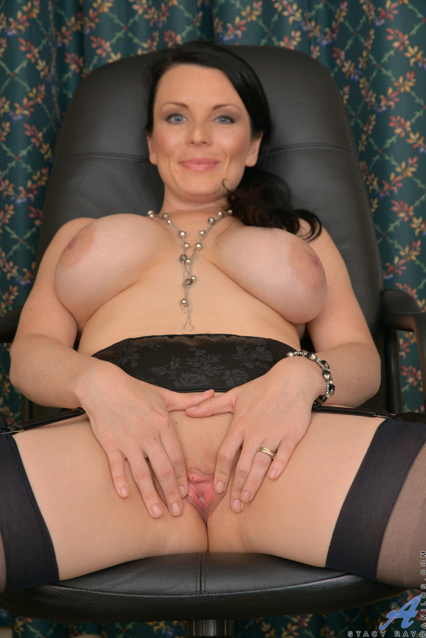 Busty Canadian MILF with ponytail Stacy Ray strips and rubs her beaver