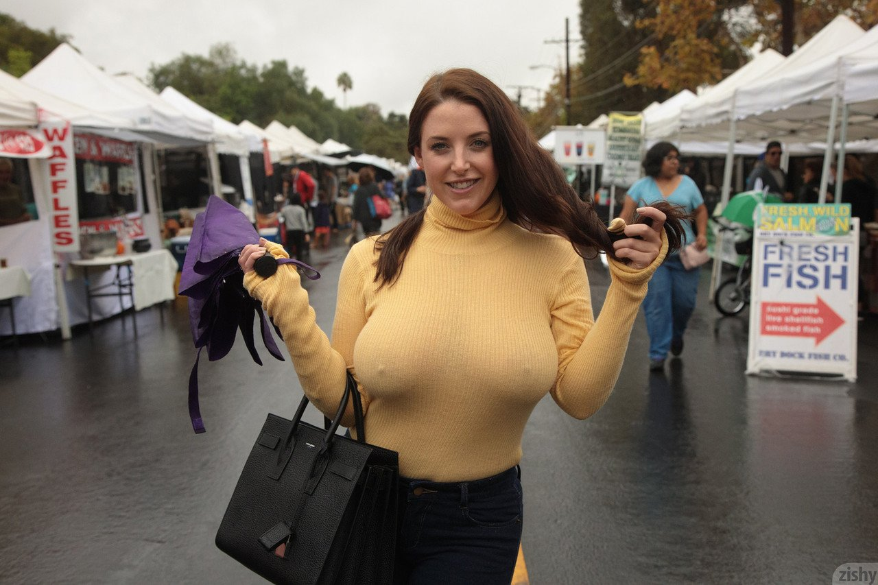 Curvaceous babe Angela White strips her bra and teases with her nips in public