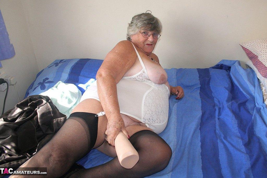 Overweight artist amateur Grandma Libby sticks a faux hand inside her vagina